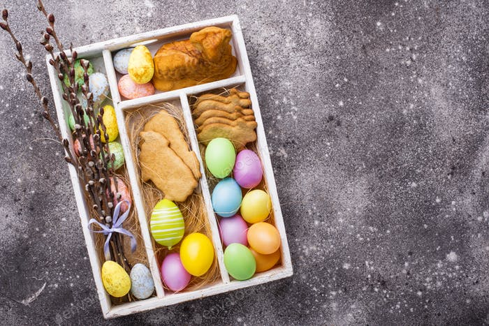 Box with Easter cookies and eggs