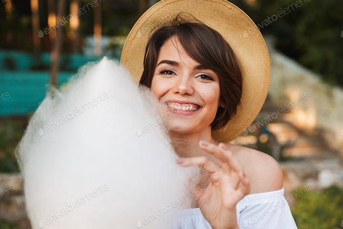 Close up of smiling young girl dressed in summer clothes
