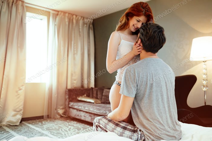 Happy couple in bed showing emotions and happy