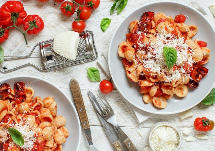 South italian  pasta orecchiette with tomato sauce and cacioricotta cheese