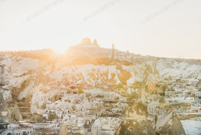 Sunset over Goreme village, cave houses and Uchisar castle, Cappadocia