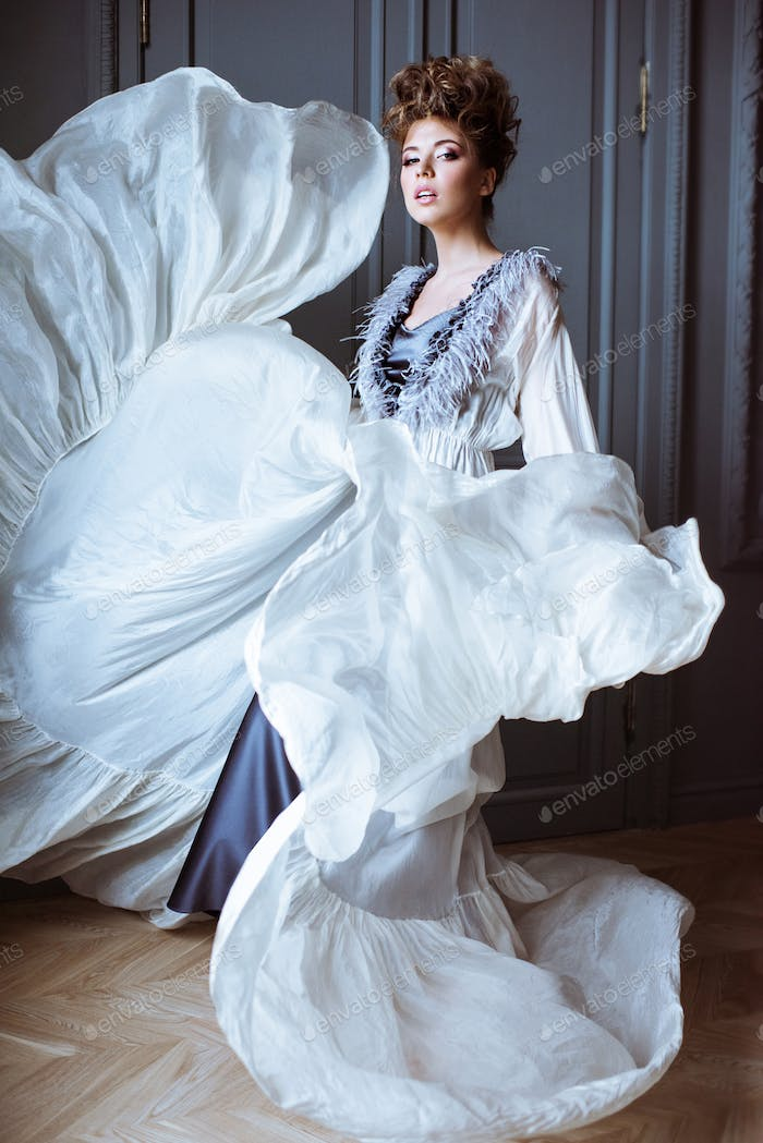 Fashionable female portrait of cute lady in dress indoors