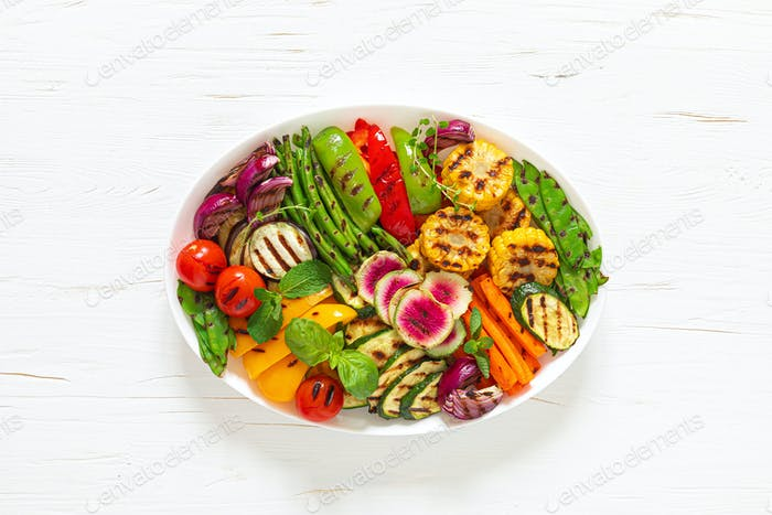 Grilled vegetables on a white plate, top view