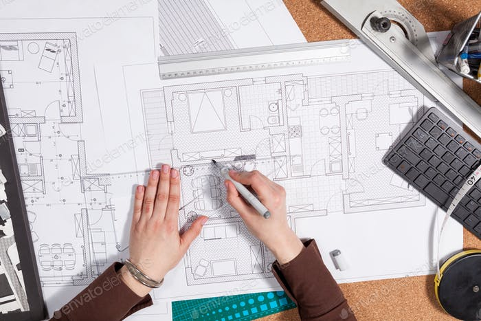 Close up of architect desk with blueprints