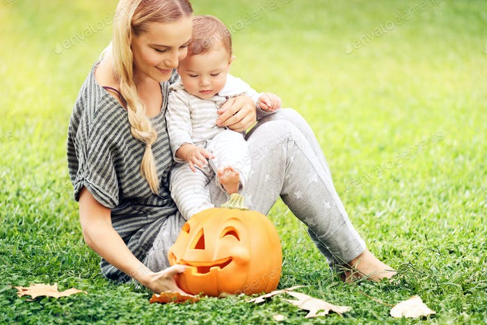 Happy mother and baby outdoors