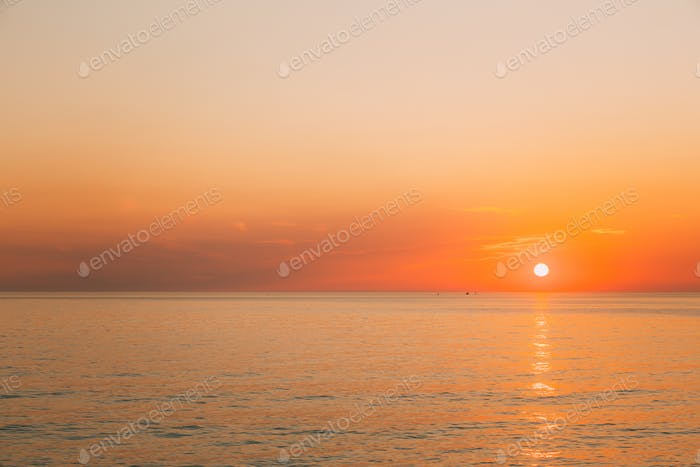 Sun Is Rising On Horizon At Sunset Or Sunrise Over Evening Sea O
