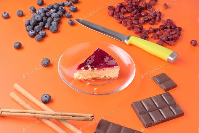 portion of cheese cake with other ingredients isolated on strong colorful background