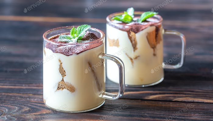 Two glass mugs of tiramisu