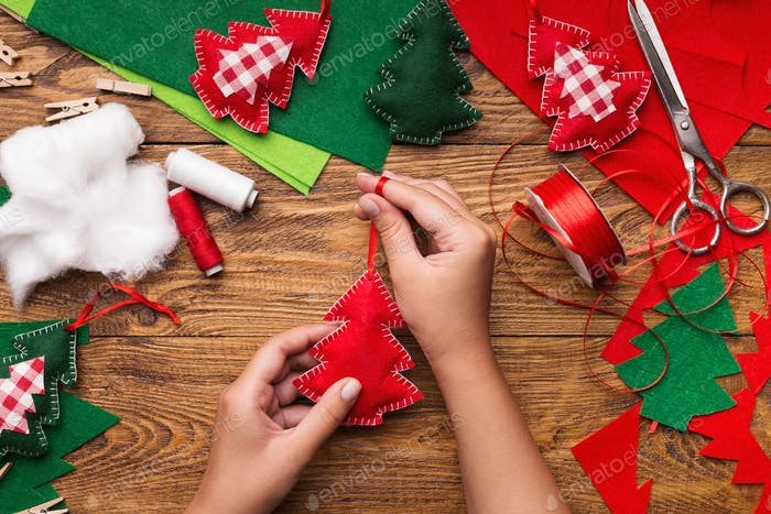 Making of handmade christmas toys from felt