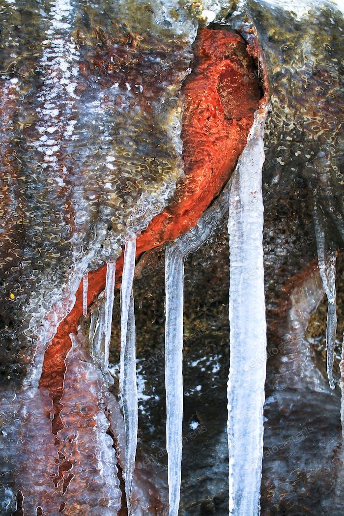 Icicles on Orange Volcanic Rock in New Zealand