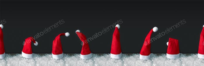 seamless row of red Santa Claus hats