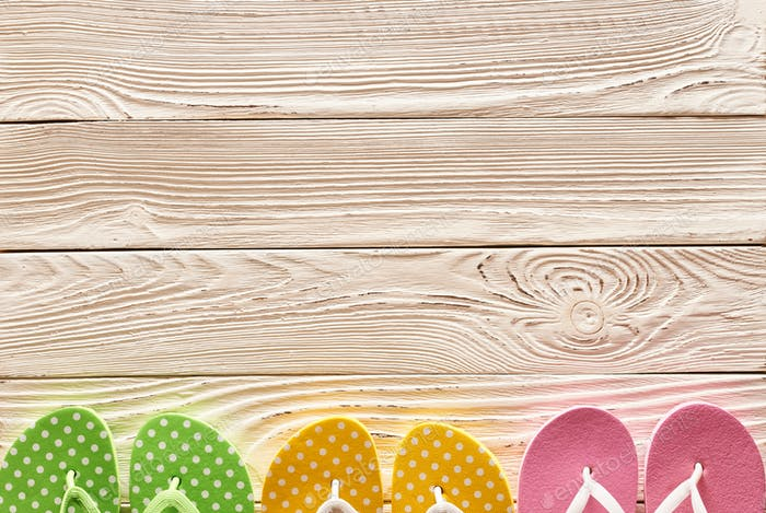 Flip-flops over wooden background