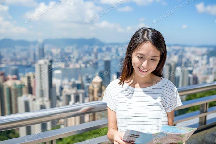 Woman looking at the city map in Hong Kong