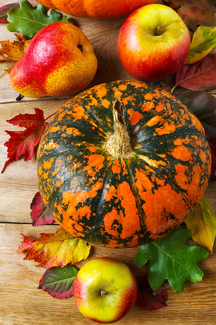 Fall decor with pumpkin, apples, pear, red leaves