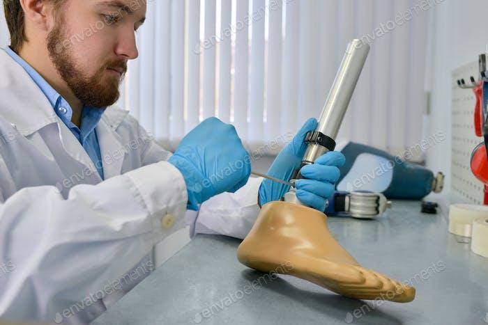 Prosthetist Repairing Artificial Leg