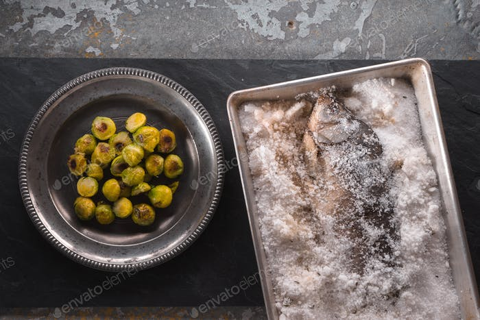 Fish baked in salt and brussels sprouts