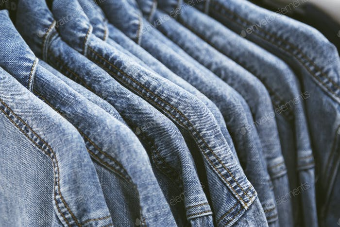 fashion jeans jacket on hangers.