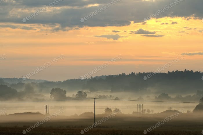 Dawn over rural countryside