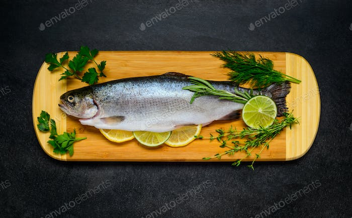 Raw Trout Fish Prepared for Cooking and on Wooden Copping Board