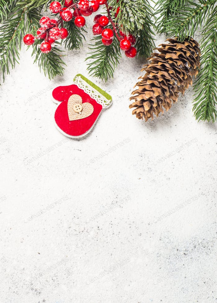 Christmas flatlay with fir tree and decorations on white  backg