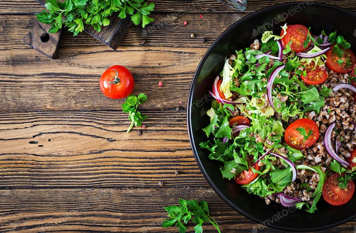Buckwheat salad with cherry tomatoes, red onion and fresh herbs.