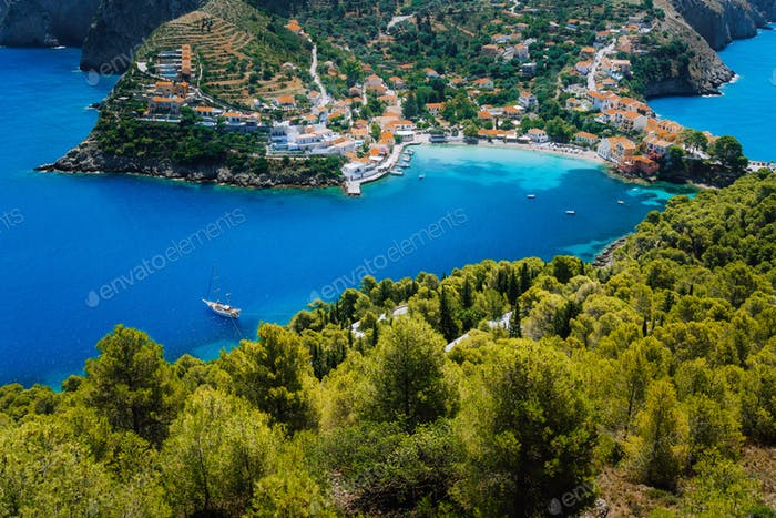 Breathtaking top view to Assos village with local houses. Landmark place of Kefalonia. Lonely white