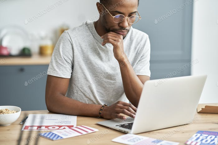 Black man focused on searching information about election