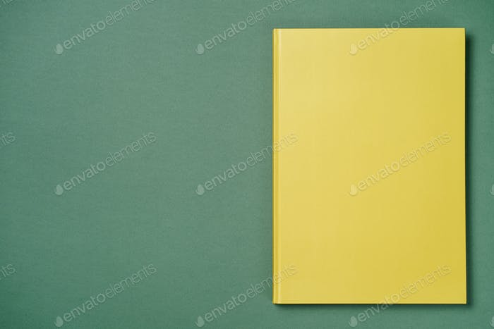 Green leather notebook on a green background