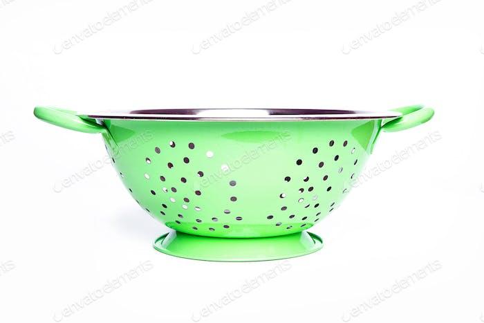 Green colander on white background