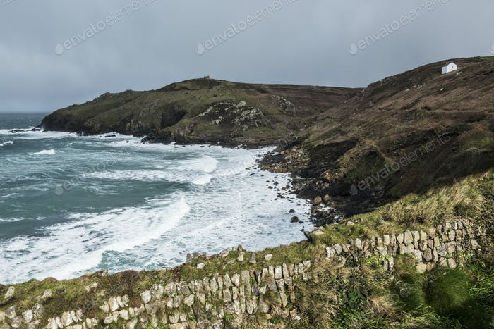 Cot Valley, St Just. View down from the cliff path over the bay and waves crashing against the