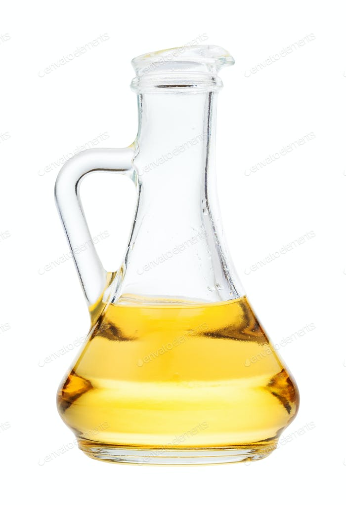 side view of glass jug with vegetable oil isolated