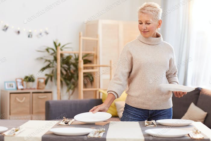 Woman serving the table at home