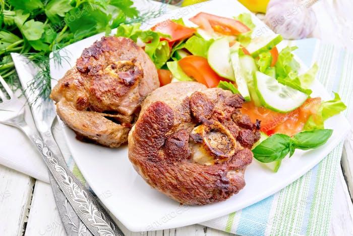 Turkey steak roasted with vegetables on table