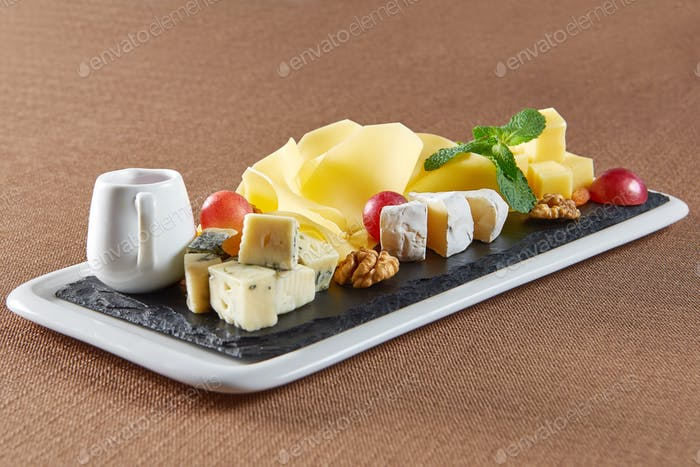 Delicious cheese plate on a restaurant table