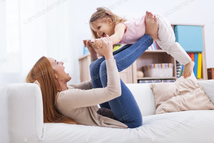 Loving mother and daughter have fun together