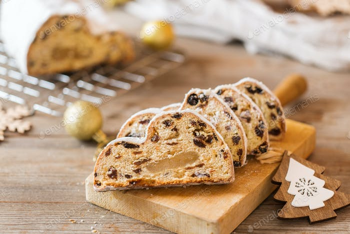 Traditional European German Christmas homemade Stollen with festive decoration