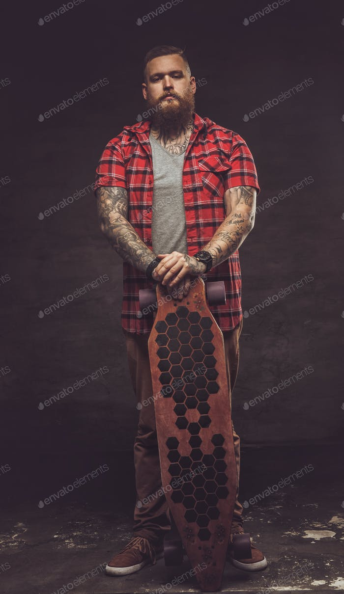 Bearded hipster man in red shirt.
