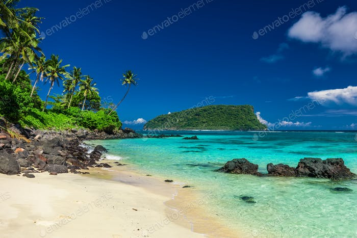 Vibrant tropical Lalomanu beach on Samoa Island with coconut pal