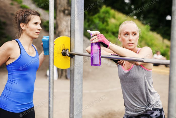 Women relaxing at outdoor gym