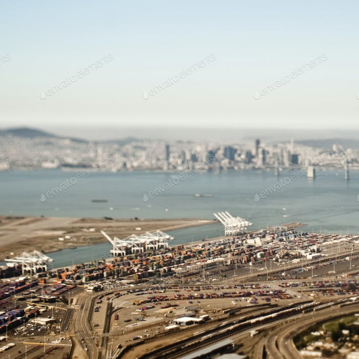 Aerial view of freight harbour with San Francisco skyline.