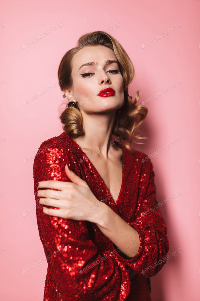Young gorgeous woman with wavy hairstyle and red lips in bright