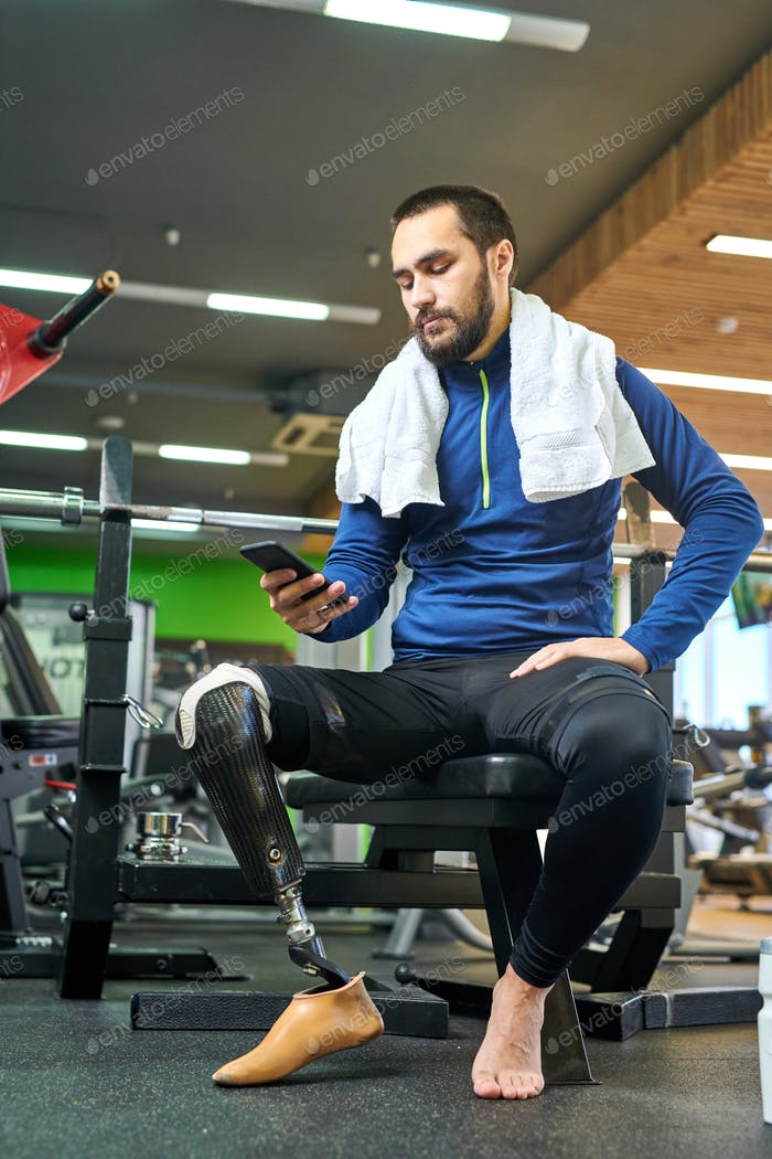 Disabled sportsman using his smartphone