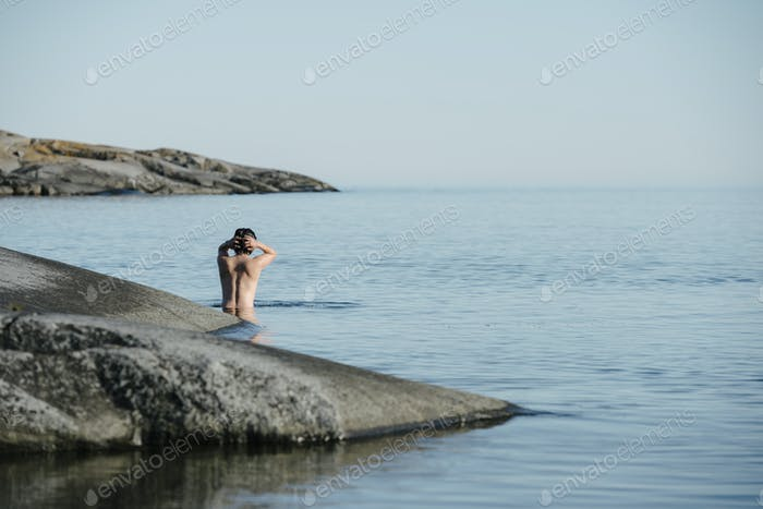Woman wading in water