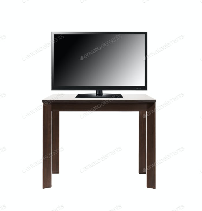 black tv screen on brown table