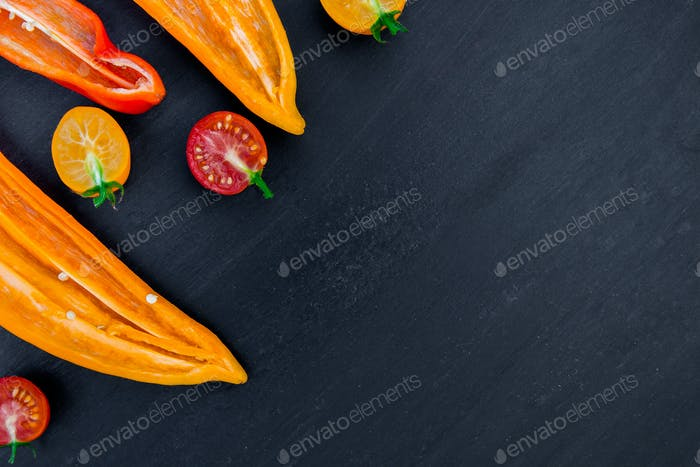 Mixed of half red and yellow pepper with a green branch