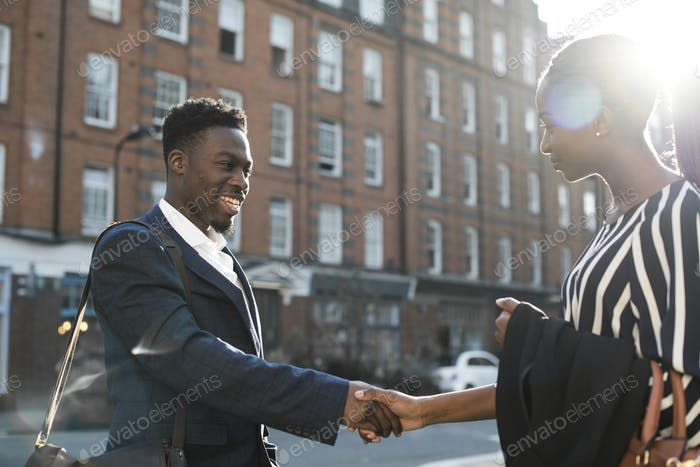 New business acquaintances shaking hands