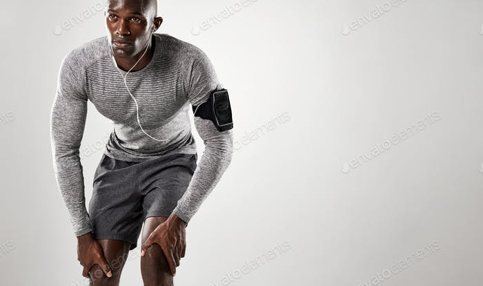 Young african man with armband and earphone