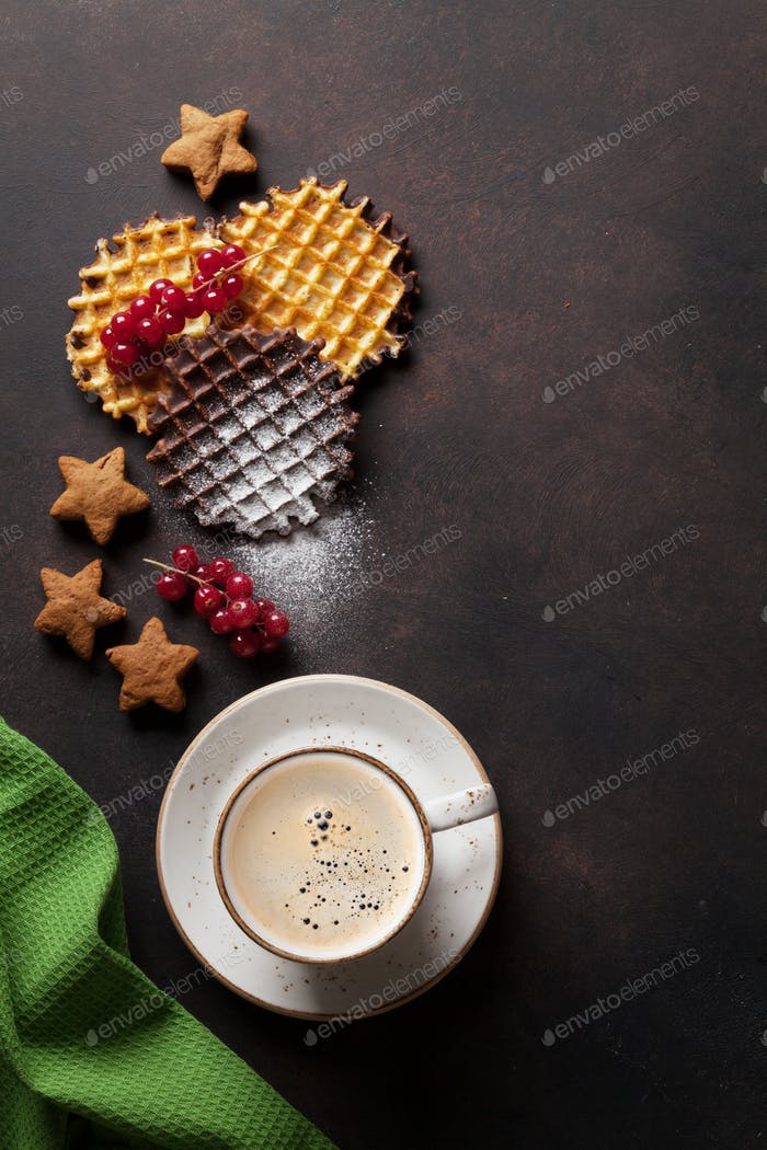 Coffee and waffles with berries