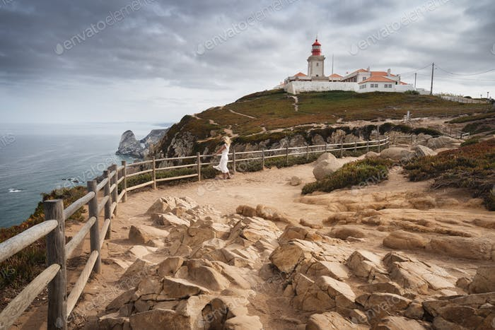 Cape Roca with red lighthouse. Sintra Portugal. Travel and tourism landmark with beautiful coastline