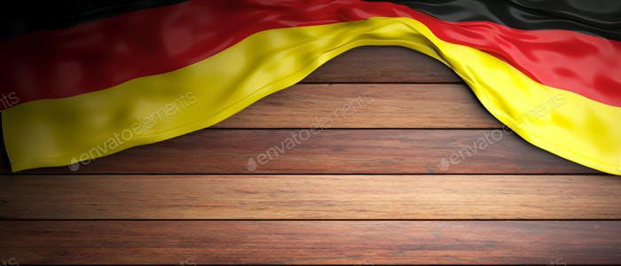 Germany flag placed on wooden background with copyspace. 3d illustration
